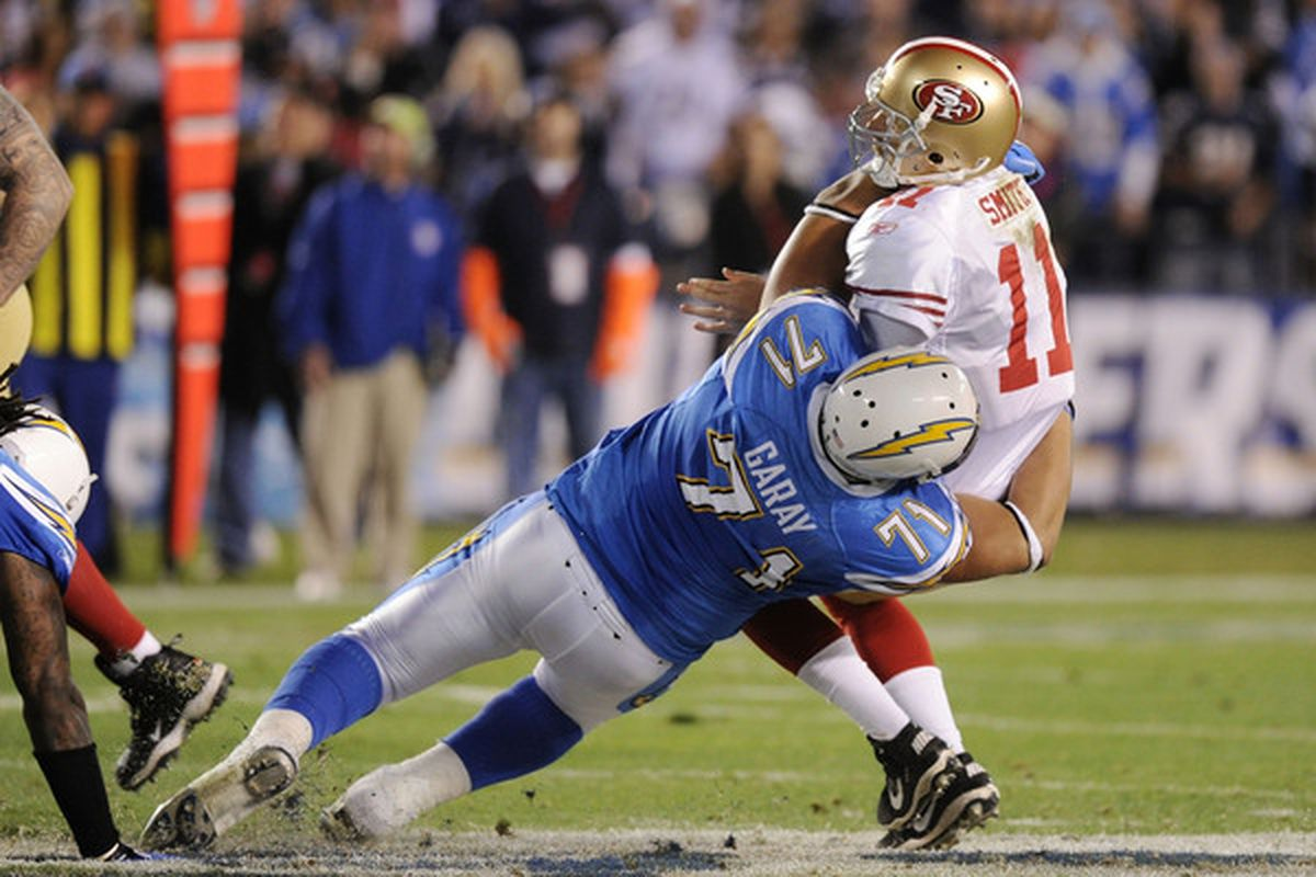 SAN DIEGO CA :  Quarterback Alex Smith #11 of the San Francisco 49ers is sacked by defensive tackle Antonio Garay #71 of the San Diego Chargers in the second quarter at Qualcomm Stadium in San Diego California.  (Photo by Harry How/Getty Images)