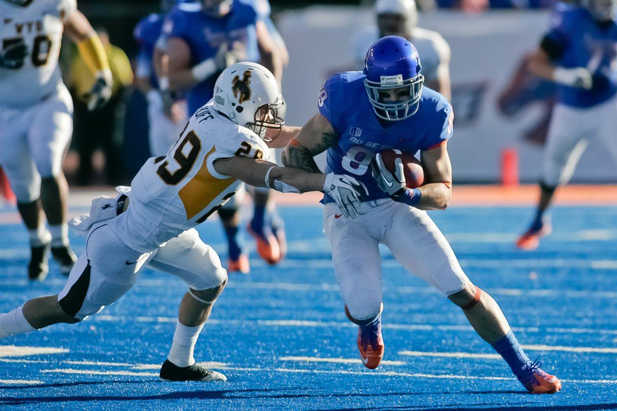 BOISE, ID - NOVEMBER 26: Tyler Shoemaker #89 of the Boise State Broncos runs the ball against Luke Ruff #29 of the Wyoming Cowboys at Bronco Stadium on November 26, 2011 in Boise, Idaho.  (Photo by Otto Kitsinger III/Getty Images)
