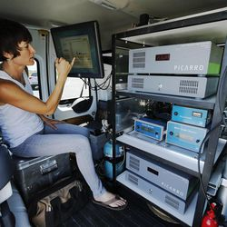 """University of Utah post-doctoral Scholar Susan Bush looks over data in the """"Nerd Mobile"""" received from an aerostat used to study ozone at Ogden Bay Waterfowl Management Area near the Great Salt Lake Wednesday, June 17, 2015. The Utah Department of Environmental Quality's air quality scientists and researchers from Utah universities are deploying sensors this summer to detect smog-forming ozone."""