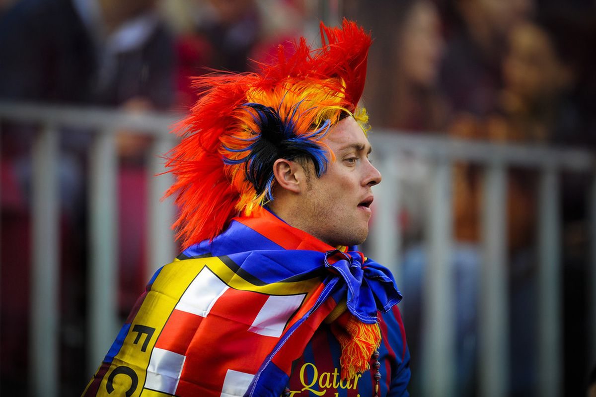 BARCELONA, SPAIN - APRIL 21: A FC Barcelona supporter looks on prior to the La Liga match between FC Barcelona and Real Madrid at Camp Nou on April 21, 2012 in Barcelona, Spain. Real Madrid CF won 1-2.  (Photo by David Ramos/Getty Images)