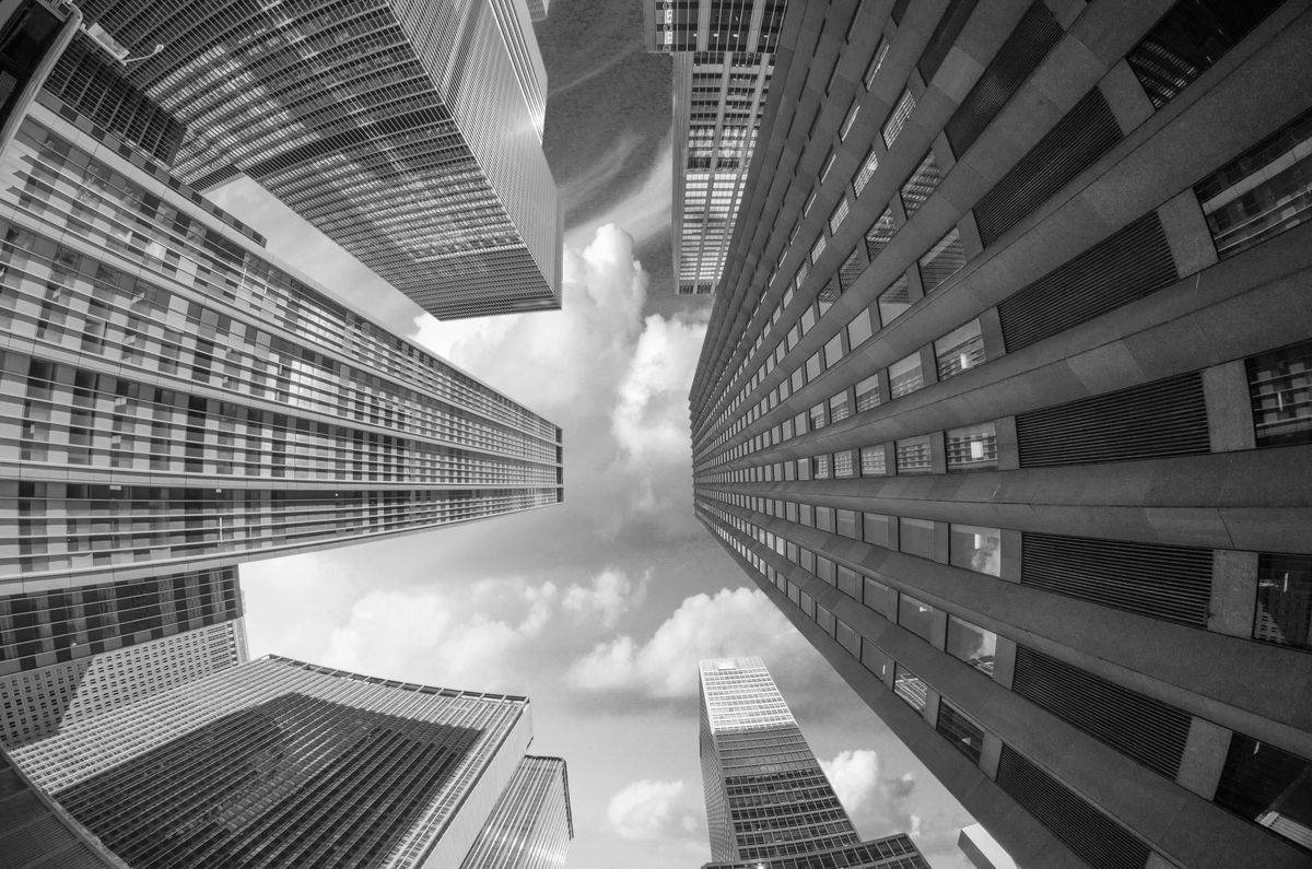 Looking up at some very tall buildings