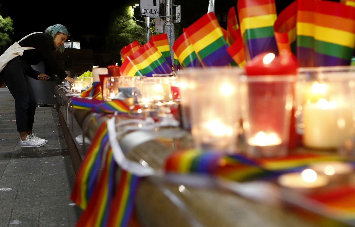 A candlelight vigil for the victims of the mass shooting at the Pulse nightclub in Florida.