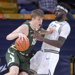 Colorado State forward James Moors (10) drives as Utah State center Neemias Queta (23) defends during the first half of an NCAA college basketball game Thursday, Jan. 21, 2021, in Logan, Utah.