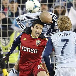 Real's Tony Beltran and Kansas City's Curelien Collin tangle for the ball as Real Salt Lake and Sporting KC play Saturday, Dec. 7, 2013 in MLS Cup action. Sporting KC won in a shootout.