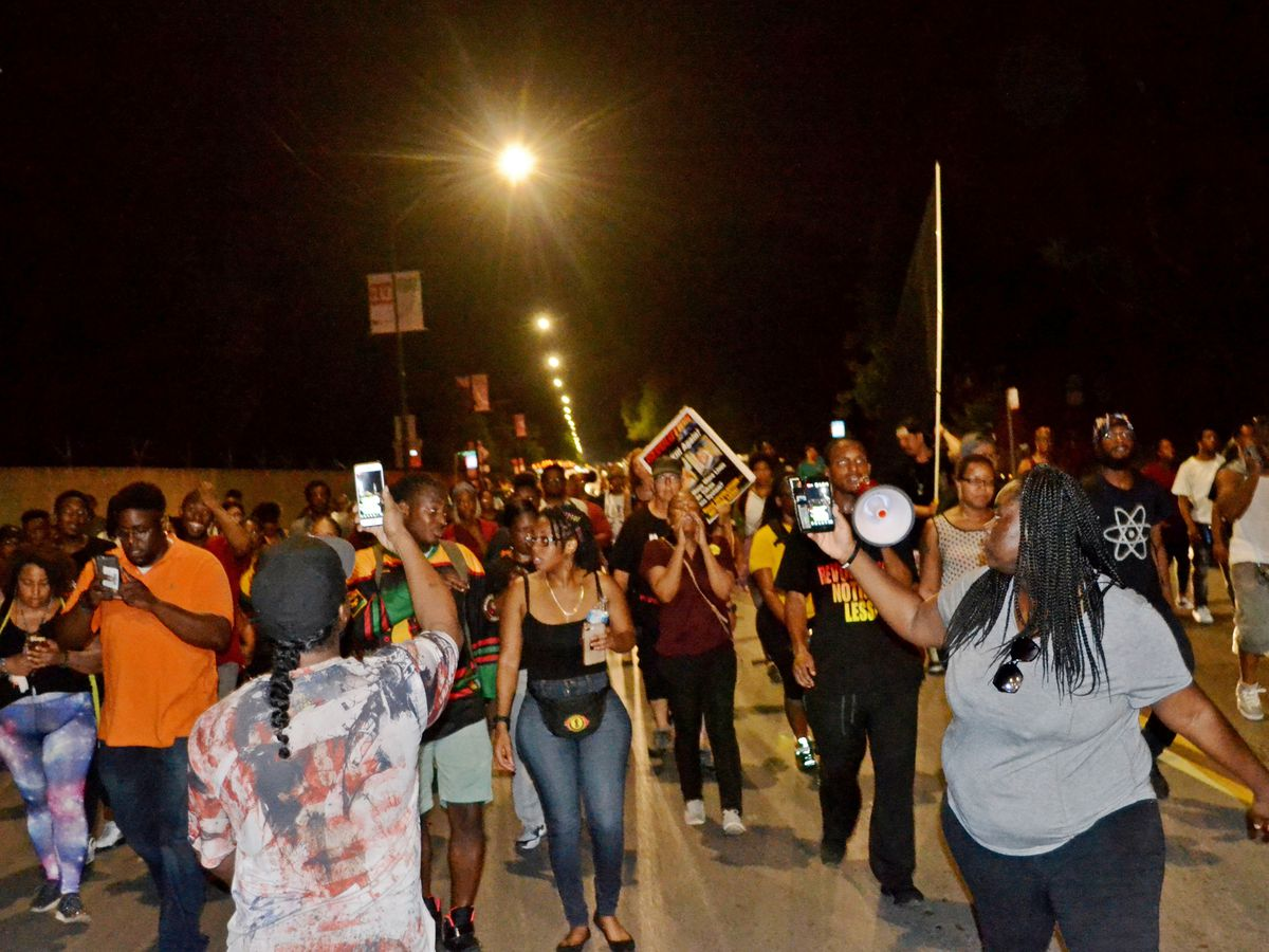 Protesters march to the 3rd District Police Station about 11:30 p.m. Saturday, July 14, 2018 in the 7000 block of South Cottage Grove Ave in Chicago. | Justin Jackson/ Sun-Times