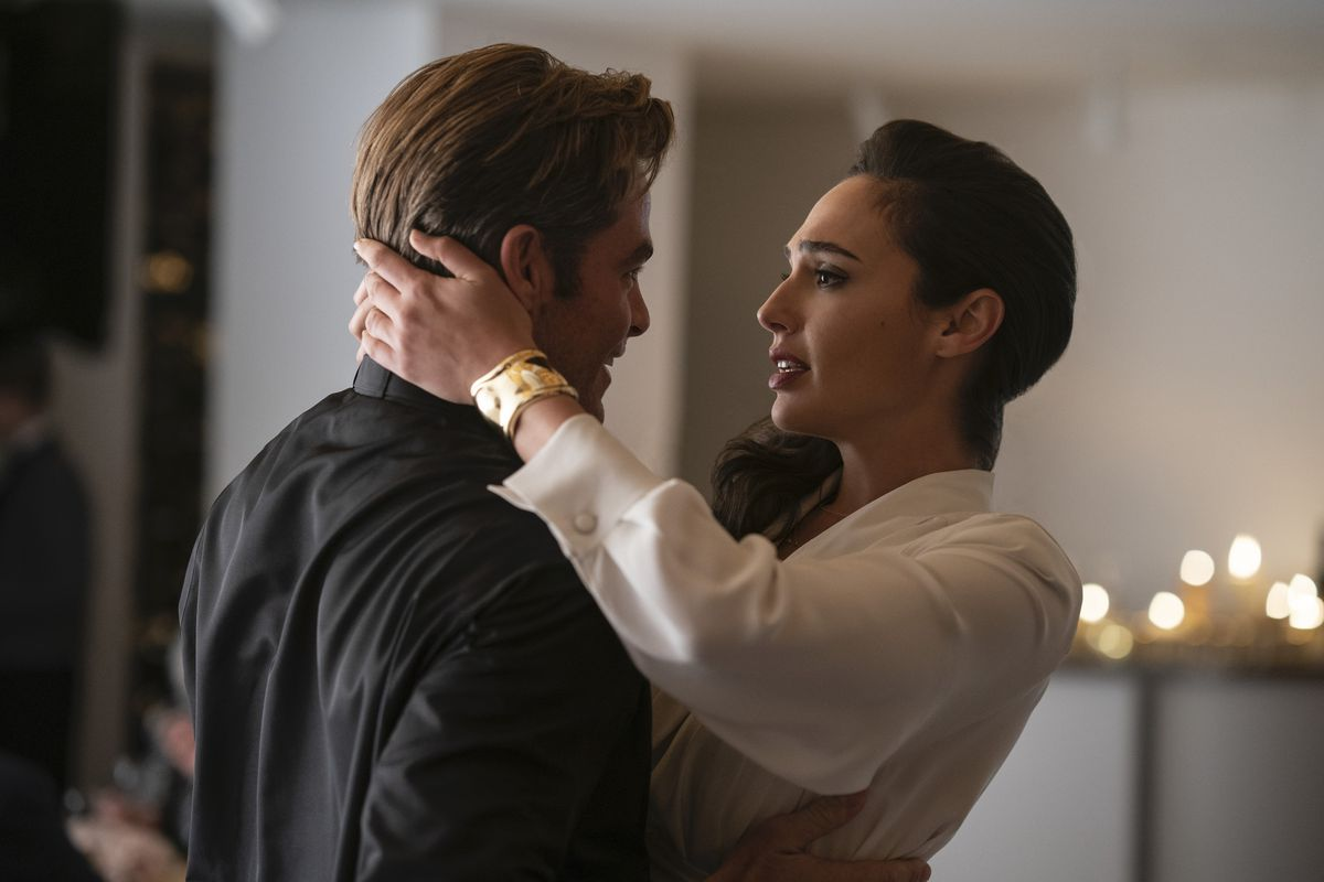 Diana holds the back of Steve Trevor's head as they reunite in Wonder Woman 1984