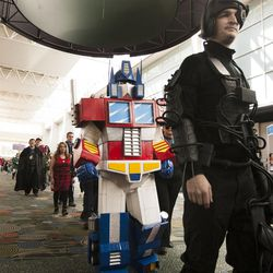 People wait to get into Salt Lake Comic Con at the Salt Palace Convention Center in Salt Lake City, Thursday, Sept. 4, 2014.
