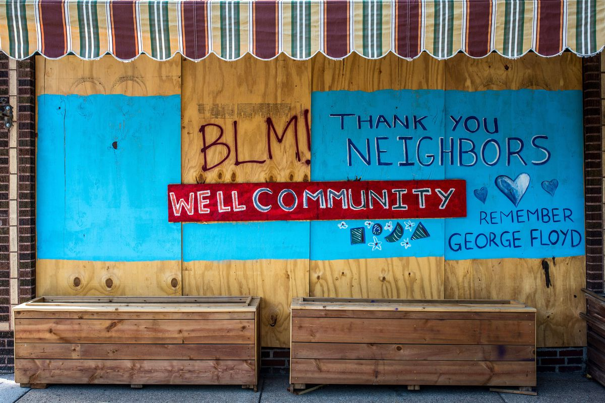 A mural supporting the Black Lives Matter movement drawn on a boarded-up business.