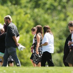 Friends and family follow the casket of Memorez Rackley and her son, Jase, at Memorial Redwood Mortuary and Cemetery in West Jordan on Tuesday, June 20, 2017.