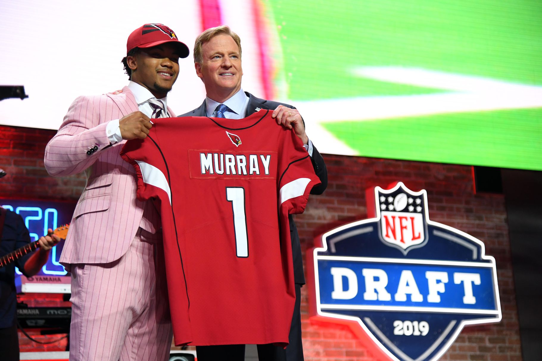 Roger Goodell presents Kyler Murray after he is taken first overall by the Arizona Cardinals in the 2019 NFL Draft