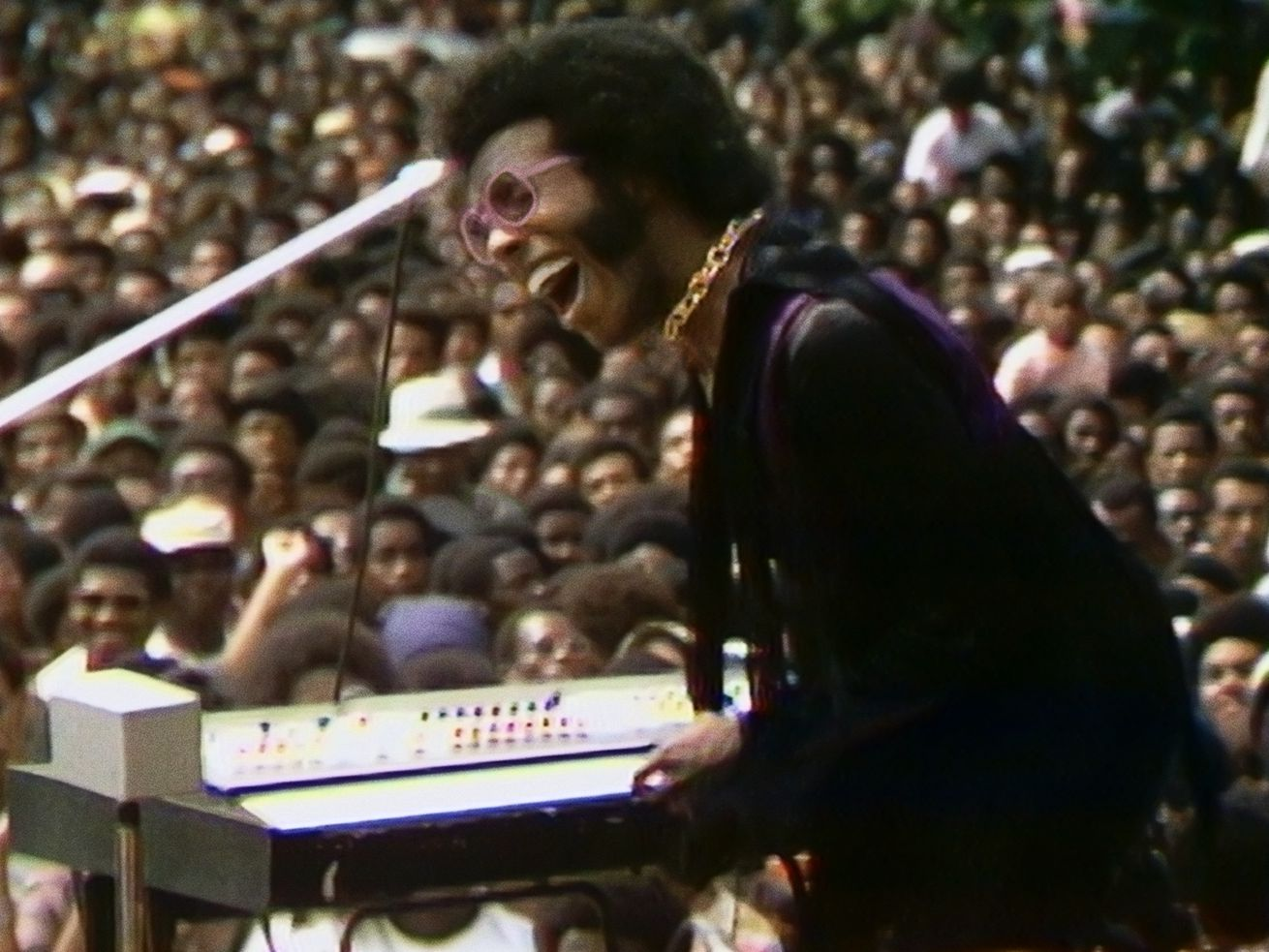 Sly Stone performs at the Harlem Cultural Festival in 1969, featured in the documentary SUMMER OF SOUL. Photo Courtesy of Searchlight Pictures.