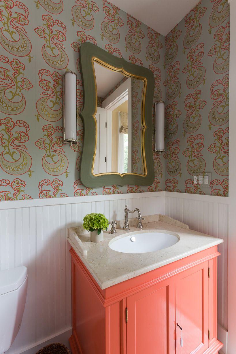 A vibrant orange bathroom vanity cabinet.