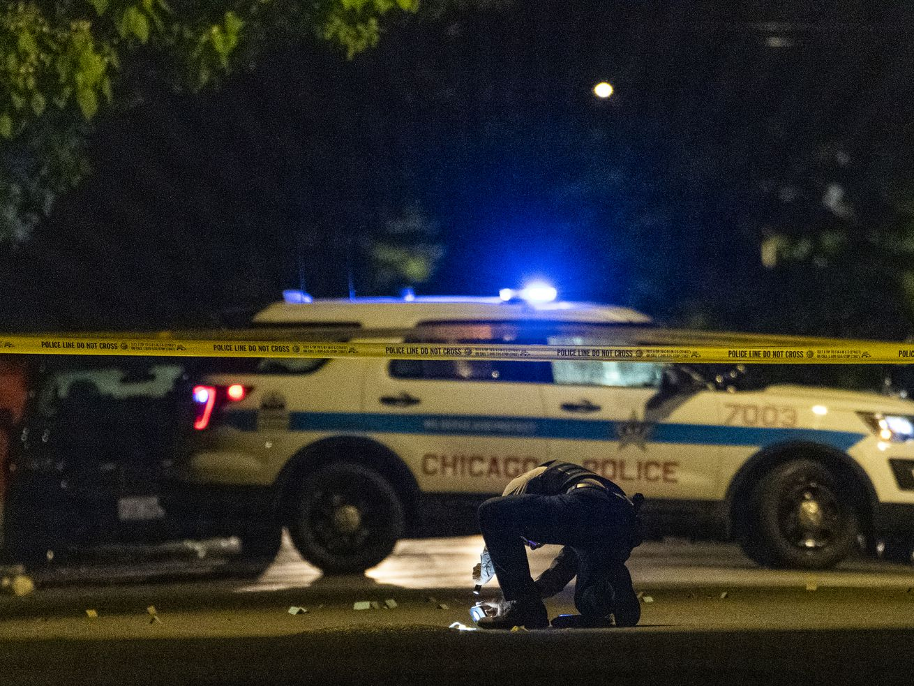 Chicago police work the scene where 27-year-old man was shot and killed in the 5600 block of S. Marshfield Ave, in the West Englewood neighborhood, Friday, June 4, 2021.