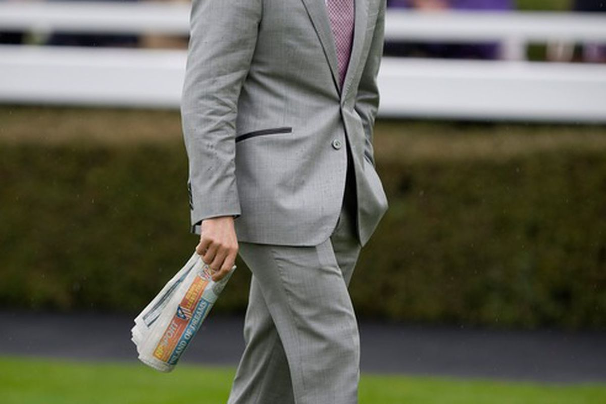 CHESTER, ENGLAND - MAY 09:  Michael Owen walks in the paddock at Chester racecourse on May 09, 2012 in Chester, England. (Photo by Alan Crowhurst/Getty Images)