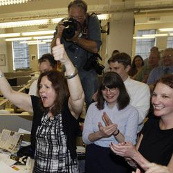 The Philadelphia Inquirer's Susan Snyder, from left, David Swanson, Martha Woodall and Kristen Graham celebrate after the paper won the Pulitzer Prize for public service, Monday, April 16, 2012, in Philadelphia. The Philadelphia Inquirer won for its exploration of pervasive violence in the city's schools, using powerful print narratives and videos to illuminate crimes committed by children against children and to stir reforms to improve safety for teachers and students.