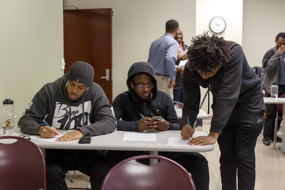 Central Michigan University freshmen, from left, Demetrius Robinson Jr., 18, Nic'Quan Webb, 18, and Keegen Williams, 18, complete worksheets during their first year experience class on Wednesday, Oct. 30, 2019 in Mount Pleasant.