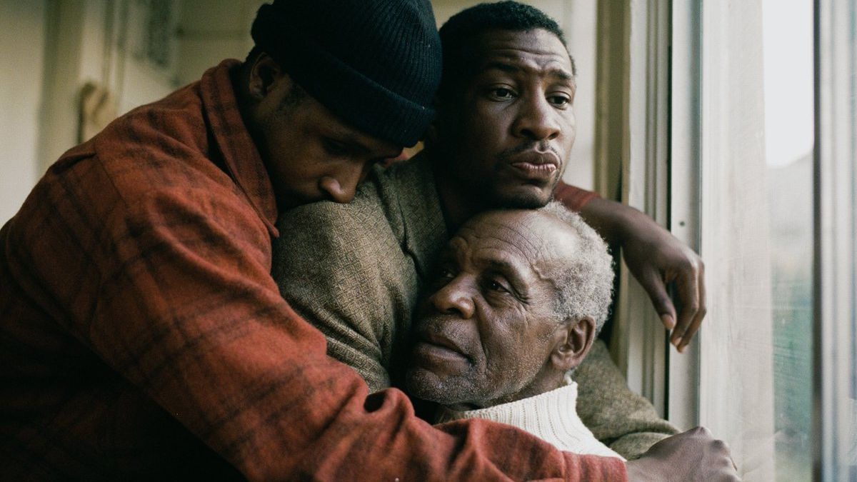 Jimmie Fails, Jonathan Majors, and Danny Glover in an embrace.