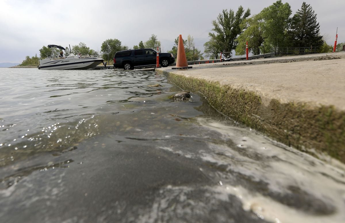A boat is pulled from the water next to a boat ramp that was closed due to low water at Willard Bay North Marina in Willard, Box Alder County, on Monday, July 19, 2021.
