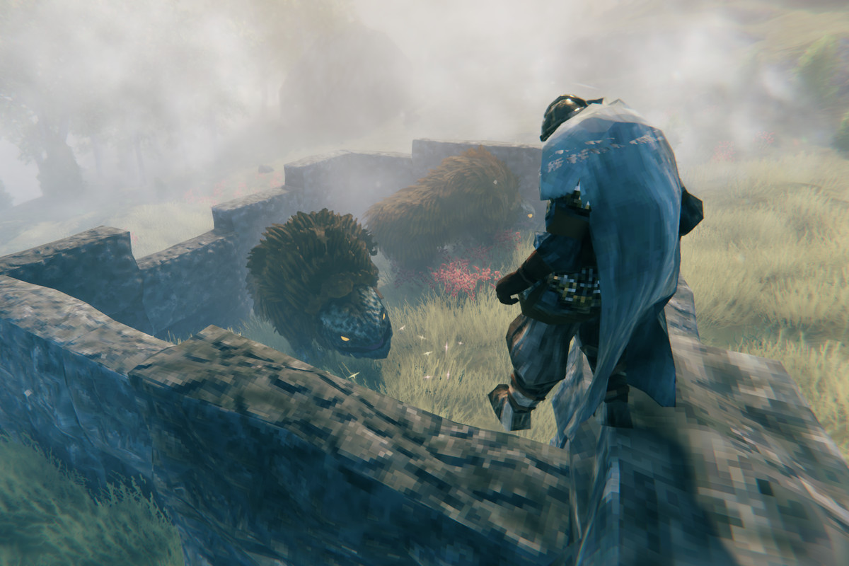 A Viking stands over a lox in Valheim