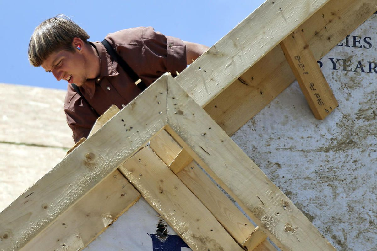 In this Thursday, June 1, 2017, photo, a builder works on the roof of a home under construction in Jackson Township, Butler County, Pa. On Monday, June 5, 2017, the Labor Department issues revised data on productivity in the first quarter.