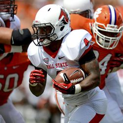 Ball State running back Horactio Banks works his way through the Clemson defense in the first half of an NCAA college football game, Saturday, Sept. 8, 2012, in Clemson, S.C.