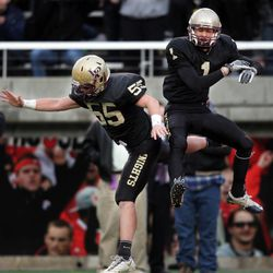 Lone Peak High School's Micah Hannemann (1) celebrates his touchdown with teammate Justin Simpson against Fremont  in the 5A State Championship game in Salt Lake City  Friday, Nov. 18, 2011.