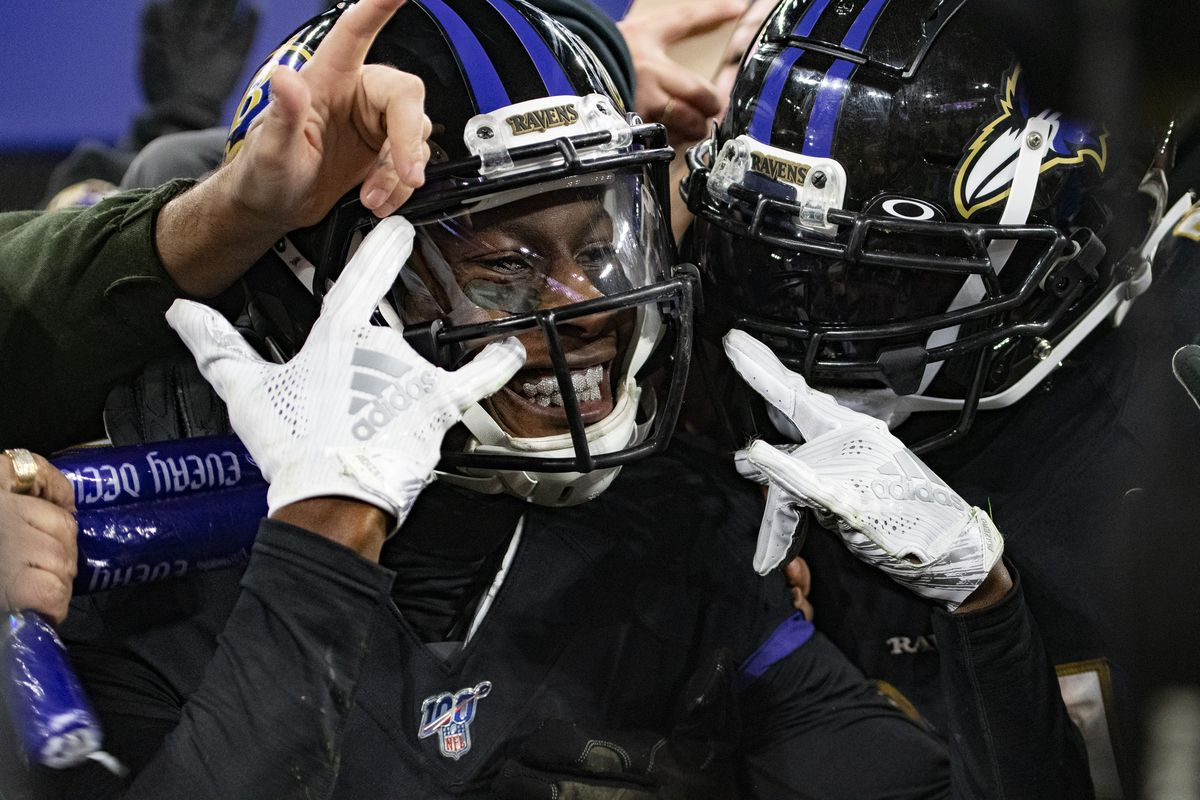 Baltimore Ravens wide receiver Marquise Brown (center) celebrates with running back Mark Ingram (right) and fans after scoring a third quarter touchdown against the New York Jets at M&T Bank Stadium.