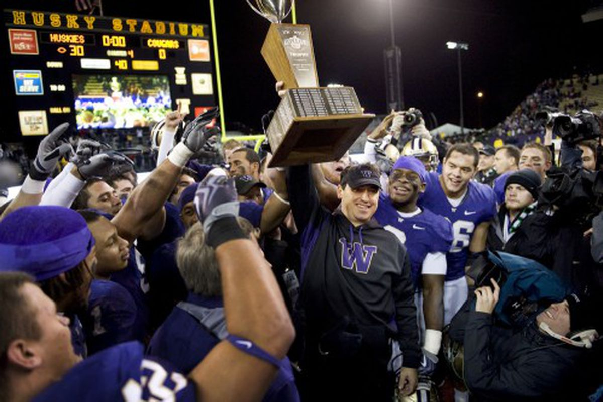 Sark has gotten quite used to hoisting the Apple Cup Trophy