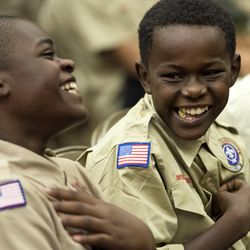 Oldie Nshimirimana, right, of Troop 1208, jokes with Isaac Mitonzi during a Court of Honor ceremony at Camp Tracy Lodge in Salt Lake City on Thursday, Sept. 28, 2016. Troop 1208 makes up one of the six refugee troops in Utah's Boy Scouts of America organization.