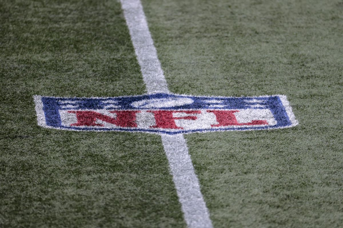 NFL logo on the field during a game between the New England Patriots and the Las Vegas Raiders on September 27, 2020, at Gillette Stadium in Foxborough, Massachusetts.