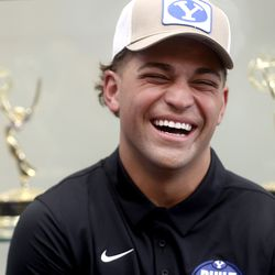 BYU running back Lopini Katoa laughs while chatting with teammates during BYU football media day at the BYU Broadcasting Building in Provo on Thursday, June 17, 2021.