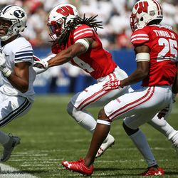 Brigham Young Cougars wide receiver Jonah Trinnaman (3) is pushed out of bounds by Wisconsin Badgers safety D'Cota Dixon (14) during the game at LaVell Edwards Stadium in Provo on Saturday, Sept. 16, 2017.