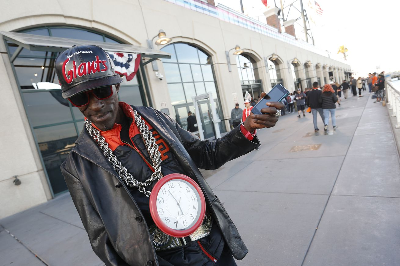 San Francisco Giants fan RT the Entertainer walks along the promenade near McCovey Cove before the Giants were eliminated in the National League Division Series by the Chicago Cubs at AT&T Park in San Francisco, Calif., on Tuesday, Oct. 11, 2016. (Jane Ty