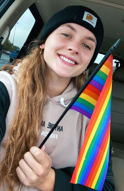 Emma Hoffart with Pride flag