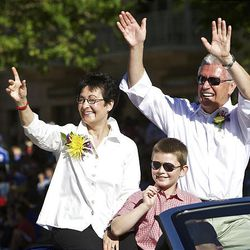 Dieter F. Uchtdorf, second counselor in the First Presidency of The Church of Jesus Christ of Latter-day Saints, right and his wife Harriet and their grandson Eric wave to the crowds gathered to watch the Days of '47 Parade in Salt Lake City Saturday.