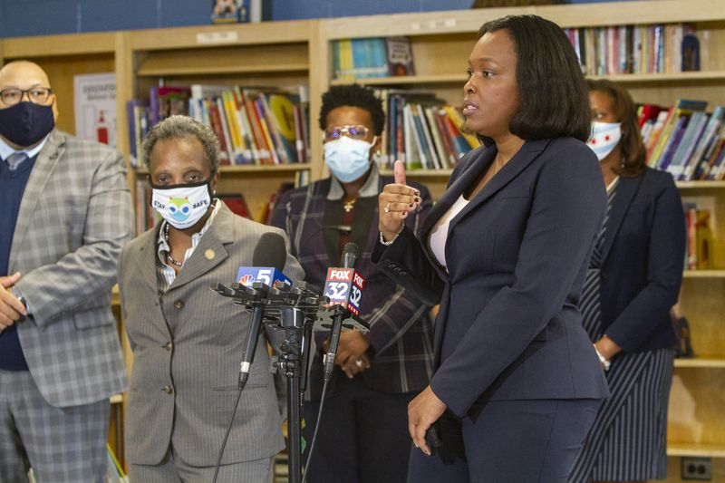 School chief Janice Jackson and Mayor Lori Lightfoot standing by microphones.