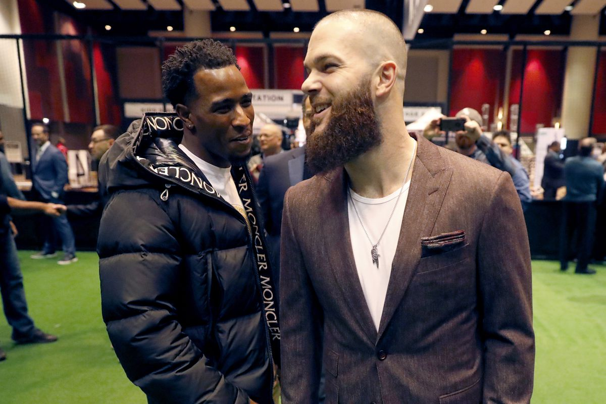 Dallas Keuchel (right) talks with new teammate Tim Anderson during SoxFest in January.