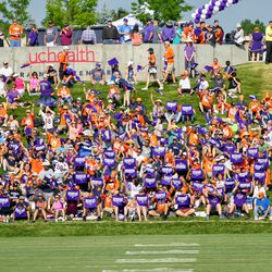 Denver Broncos fans wore purple and were given purple towels for Alzheimer's Awareness Day at training camp.