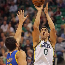 Utah's Enes Kanter puts up a shot over Warriors' Andrew Bogut as the Utah Jazz and the Golden State Warriors play Tuesday, Oct. 8, 2013 in preseason action at Energy Solutions arena in Salt Lake City.