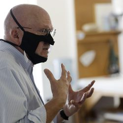 Michael Conley, who is deaf, talks while wearing a mask with a window in San Diego. Face coverings to curb the spread of the coronavirus are making it hard for people who read lips to communicate. That has spurred a slew of startups making masks with plastic windows to show one's mouth.