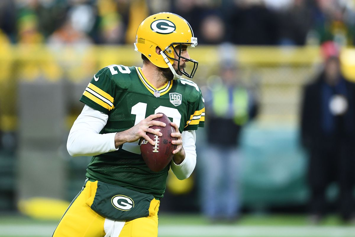 Aaron Rodgers of the Green Bay Packers drops back to pass during a game against the Miami Dolphins at Lambeau Field on November 11, 2018 in Green Bay, Wisconsin. The Packers defeated the Dolphins 31-12.