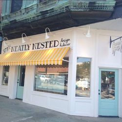 """<a href=""""http://www.neatlynesteddecor.com/"""">Neatly Nested</a> (373 West Broadway) brightens up West Broadway with a charming storefront, yellow striped awning, and robins egg blue doors. Step inside to find regionally sourced home knick knacks and repurpo"""