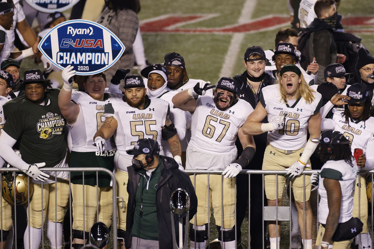 UAB Blazers players celebrate after defeating the Marshall Thundering Herd 22-13 in the Conference USA Championship at Joan C. Edwards Stadium on December 18, 2020 in Huntington, West Virginia.