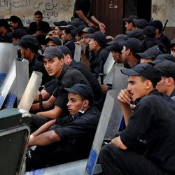 Egyptians security forces standby at the al-Fatah mosque, after hundreds of Muslim Brotherhood supporters barricaded themselves inside the mosque overnight, following a day of fierce street battles that left scores of people dead, near Ramses Square in downtown Cairo, Egypt, Saturday, Aug. 17, 2013. Authorities say police in Cairo are negotiating with people barricaded in a mosque and promising them safe passage if they leave. Muslim Brotherhood supporters of Egypt's ousted Islamist president are vowing to defy a state of emergency with new protests today, adding to the tension.