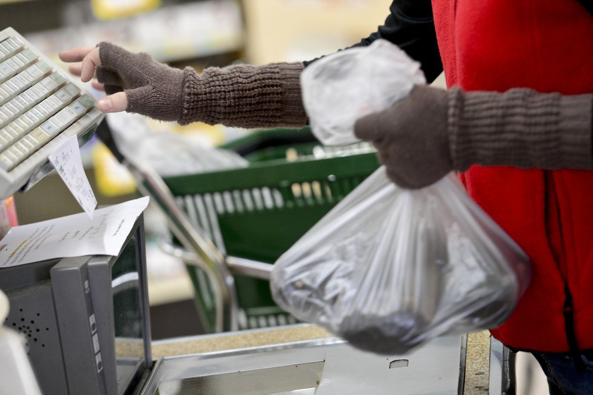 A supermarket cashier rings up groceries for a customer on Dec. 6, 2013 in Boulder, Colorado.
