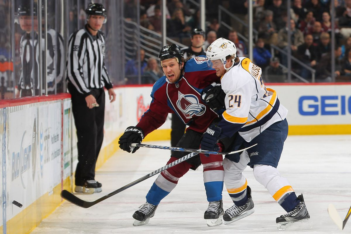 DENVER, CO - JANUARY 10:  Ryan Wilson #44 of the Colorado Avalanche and Matt Halischuk #24 of the Nashville Predators battle for control of the puck at the Pepsi Center on January 10, 2012 in Denver, Colorado.  (Photo by Doug Pensinger/Getty Images)