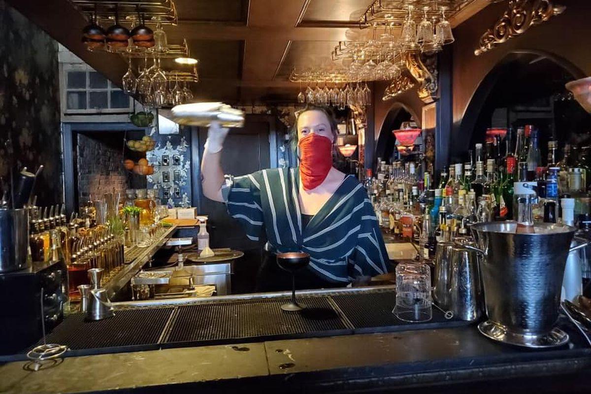 A masked bartender at Midnight Cowboy