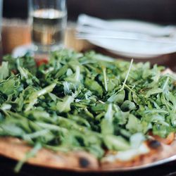 """Tomato and arugula pie from Toby's Public House by <a href=""""http://www.flickr.com/photos/naftels/6254158035/in/pool-eater/"""">naftels</a>. <br />"""
