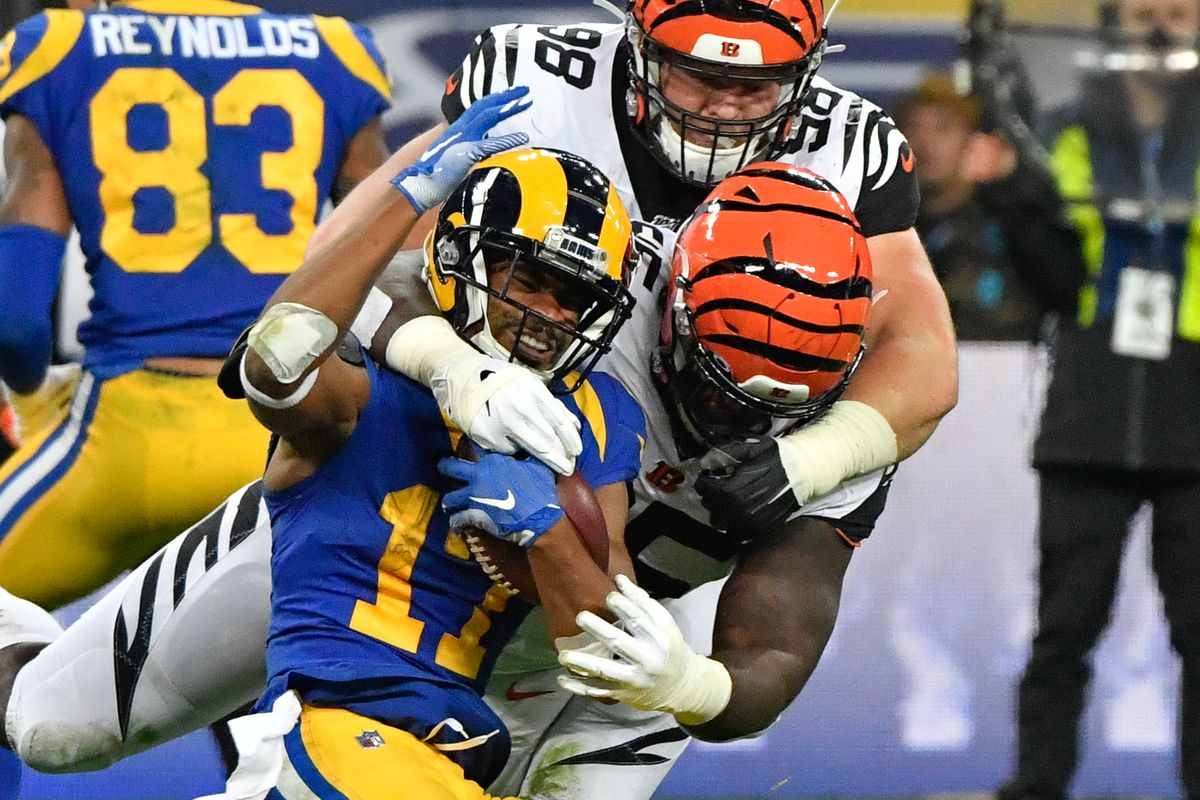 Cincinnati Bengals defensive tackle Ryan Glasgow and defensive tackle Renell Wren team up to tackle Los Angeles Rams wide receiver Robert Woods during the second half of the game between the Rams and Bengals at Wembley Stadium.