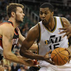 Utah Jazz power forward Derrick Favors (15) drives to the basket as Portland Trail Blazers center Meyers Leonard (11) defends in the second half of a game at the Energy Solutions Arena on Wednesday, October 16, 2013.